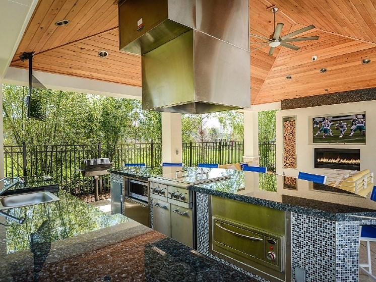 Barbecue Grills with Fireplace and Plasma TV at Altis Sand Lake, Florida