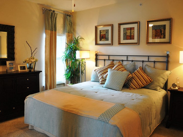 Bedroom with Framed Mirrors and Extra Storage Cabinetry at Falls at Copper Lake, Texas