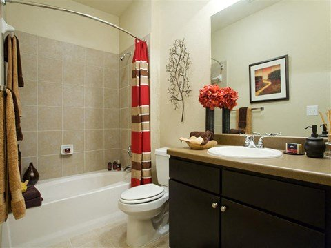 Large Soaking Tub In Master Bathroom with A Tile Surround at Yorktown Crossing, Houston, 77084