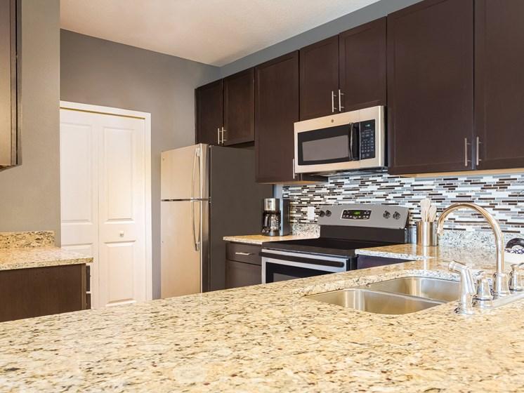 Granite Counter Tops In Kitchen at Reserves at Alafaya, Florida