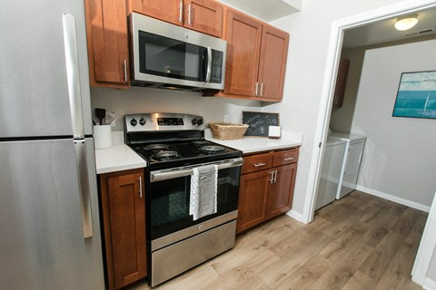 Apartments for Rent Rancho Cordova - Avion Apartments Kitchen with Updated Appliances and Wood-like Flooring