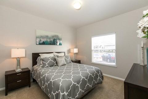 Three Bedroom Apartments in Rancho Cordova, CA - Avion Apartments Bedroom with Window and Carpet Flooring