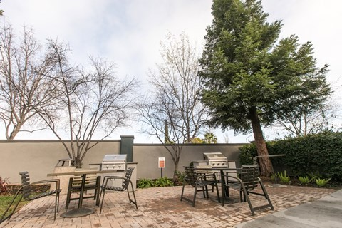Pet Friendly Apartments in Rancho Cordova, CA - Avion Apartments BBQ Grilling Area with Outdoor Dining Tables and Chairs