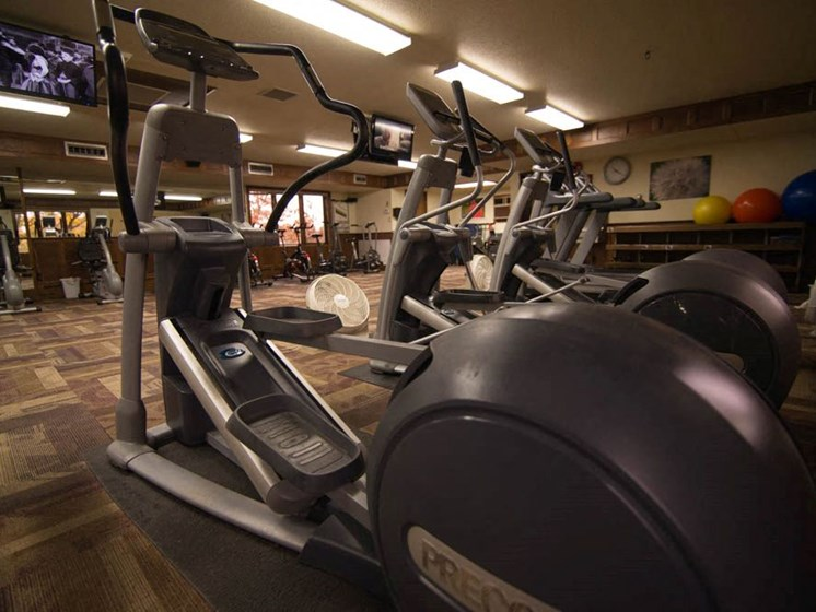 Fitness center with exercise machines at Tourville Apartments in Marquette, MI