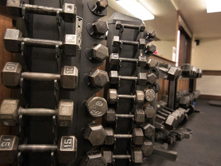 Fitness Center with Free Weights at Tourville Apartments in Marquette, MI