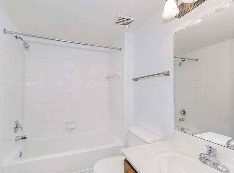 Bathroom with White Counters and Tiled Shower with Bathtub