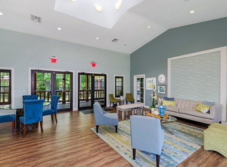 Clubhouse Seating Area with Blue and Grey Chairs and a Grey Couch