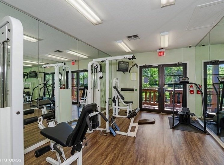 Fitness Center with Exercise Equipment With 2 Mirrored Walls