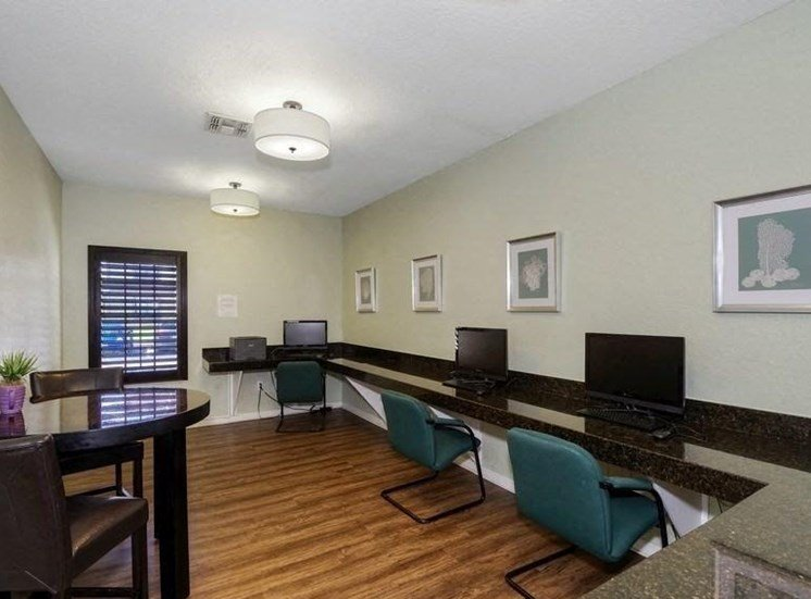 Business Center with High Top Table and Chairs and Granite Counter with Computers  and Green Chairs
