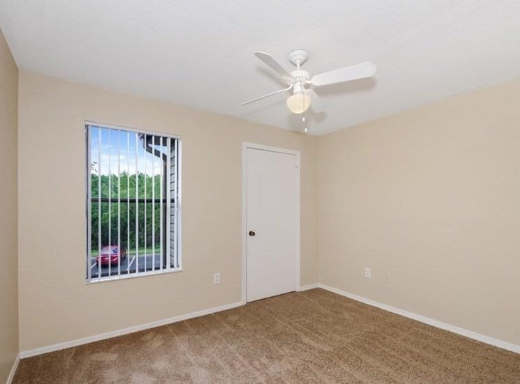 Living Room with Window Next to Front Door and Ceiling Fan
