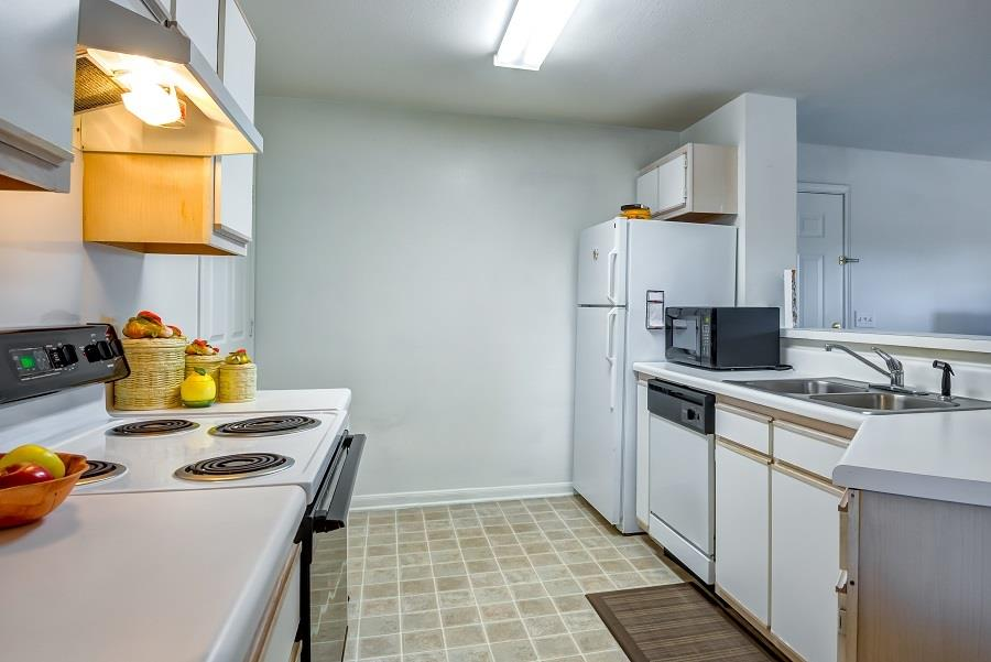 Model Kitchen with White Counters Cabinets and Appliances