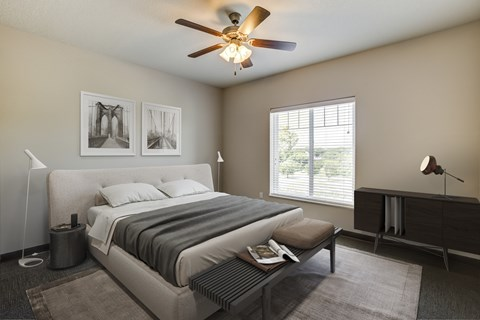 Fairway Flats Apartments Carpeted Bedroom with Large Window and Ceiling Fan