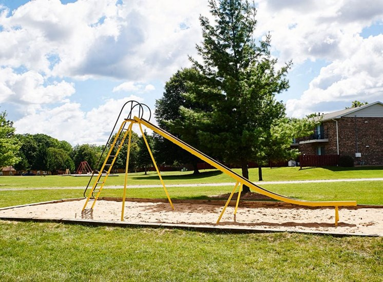 Play Park with slides, swings, and more at Cambridge Square in Grand Rapids