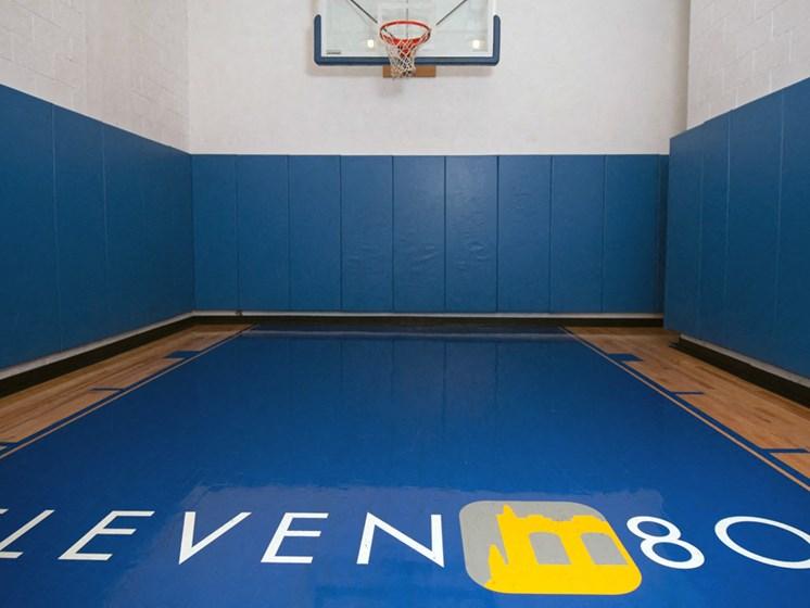 Indoor basketball court with property logo on floor