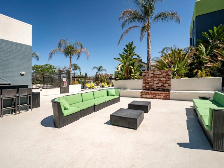 outdoor seating area green couch cushions