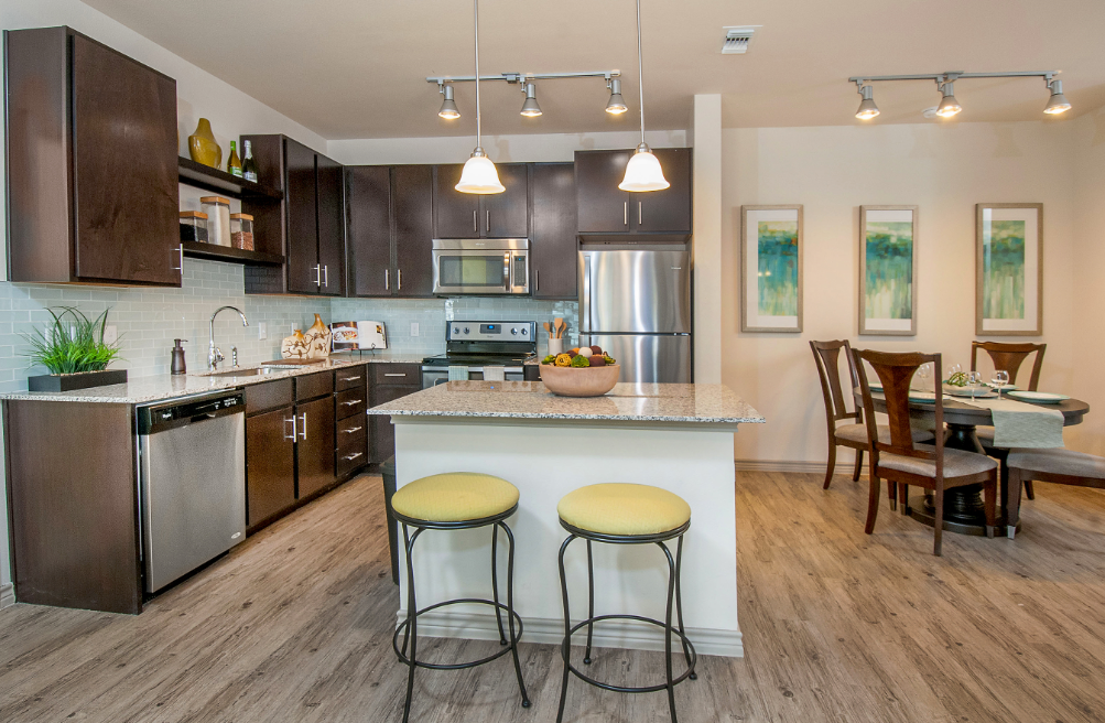 Kitchen with island, bar seating & dining room