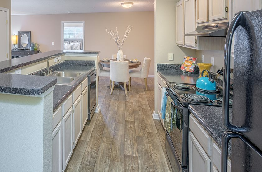 Kitchen With Dishwasher at Southpoint Crossing, Durham, North Carolina