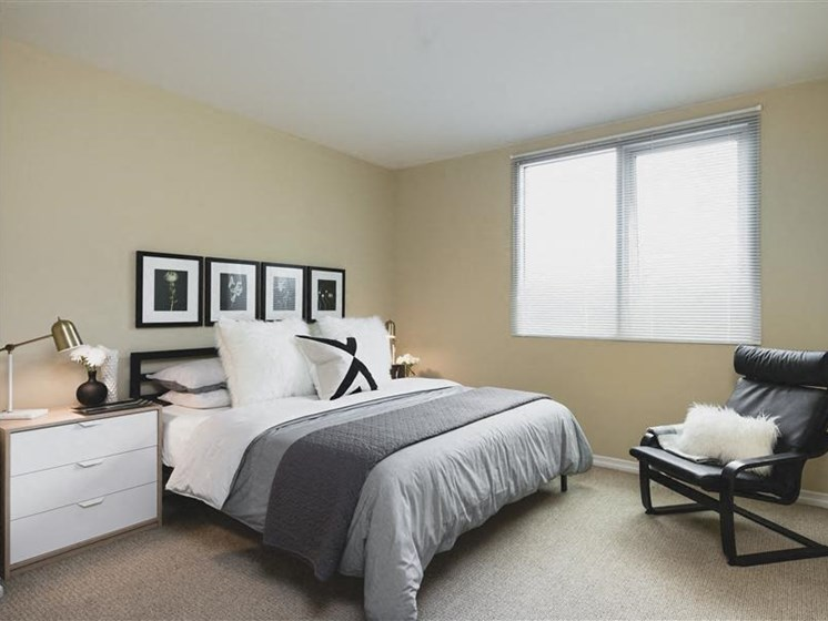 Bedroom with modern recliner chair