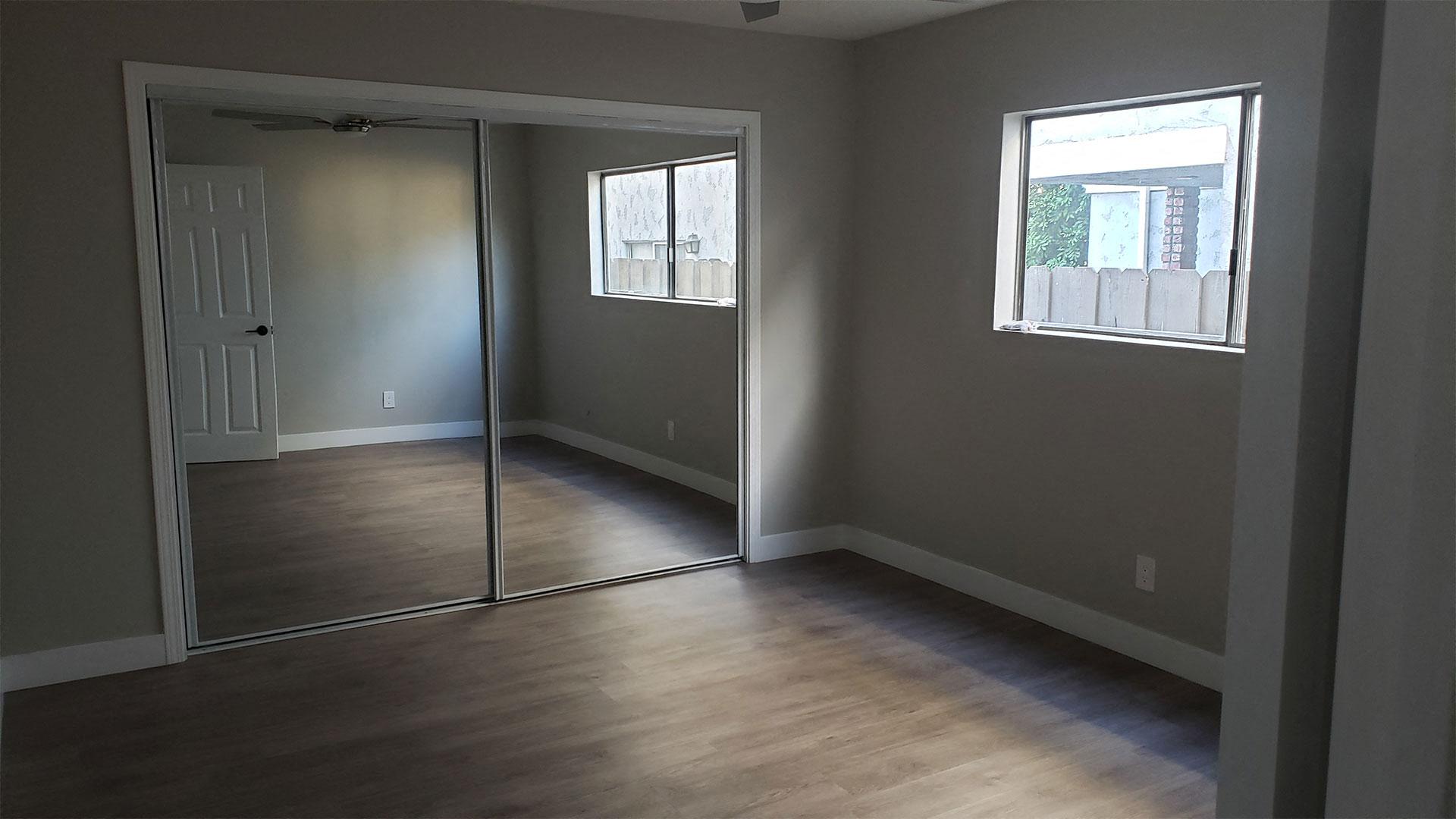 Sliding Door Closet with Mirror in Bedroom at Wilson Apartments in Glendale, CA