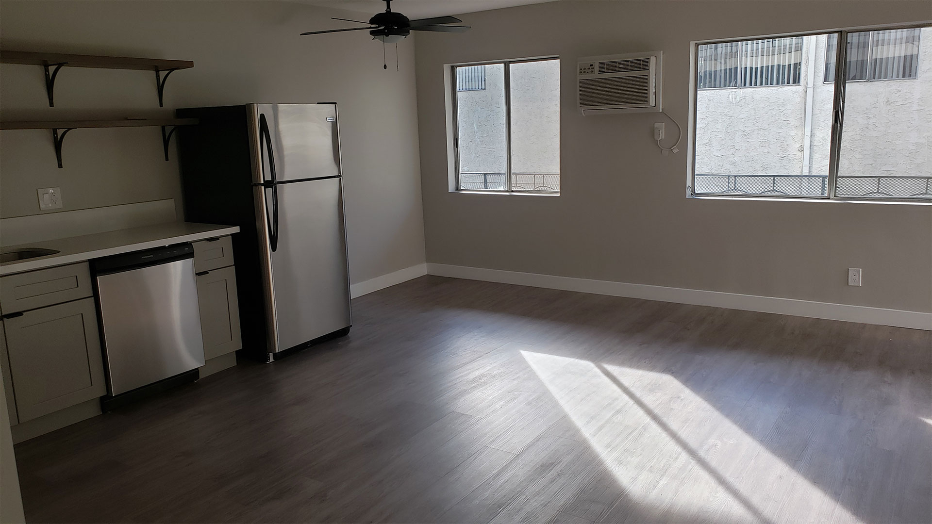 Kitchen Area With AC Unit, Hard-Wood Flooring, Plenty of Natural Light at Wilson Apartments in Glendale, CA