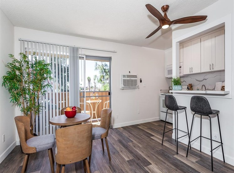 furnished dining area with ceiling fan