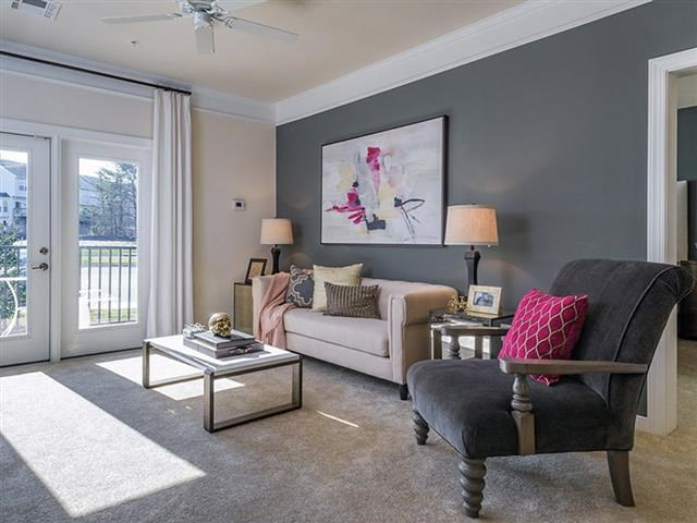 Living Room With Private Balcony at Abberly Square Apartment Homes, Waldorf, 20601