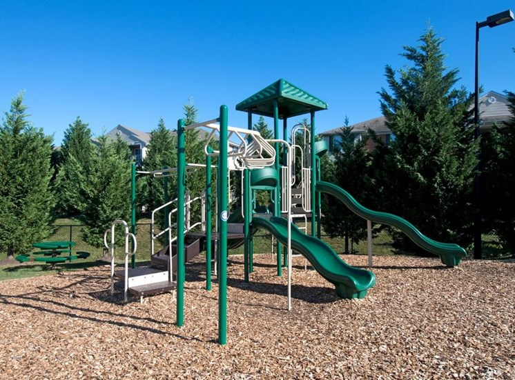 Playground With Wood Chips at Crestview Apartments, Fredericksburg