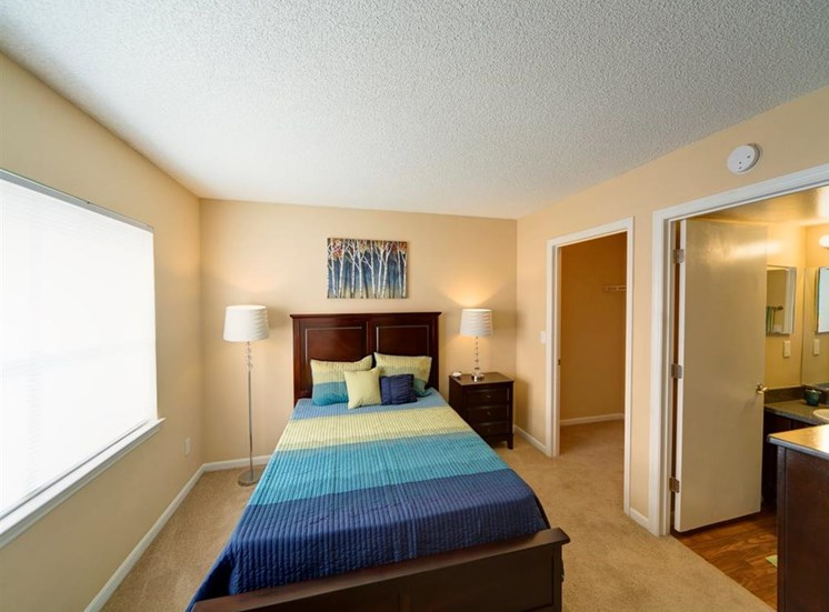 Bedroom With Expansive Windows at Holly Cove Apartments, Orange Park, 32073