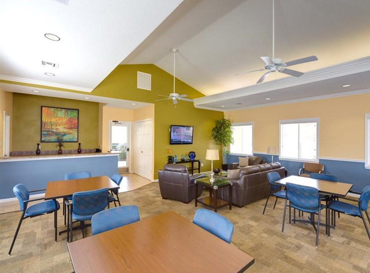 Clubhouse With Ample Sitting And Television at Holly Cove Apartments, Florida