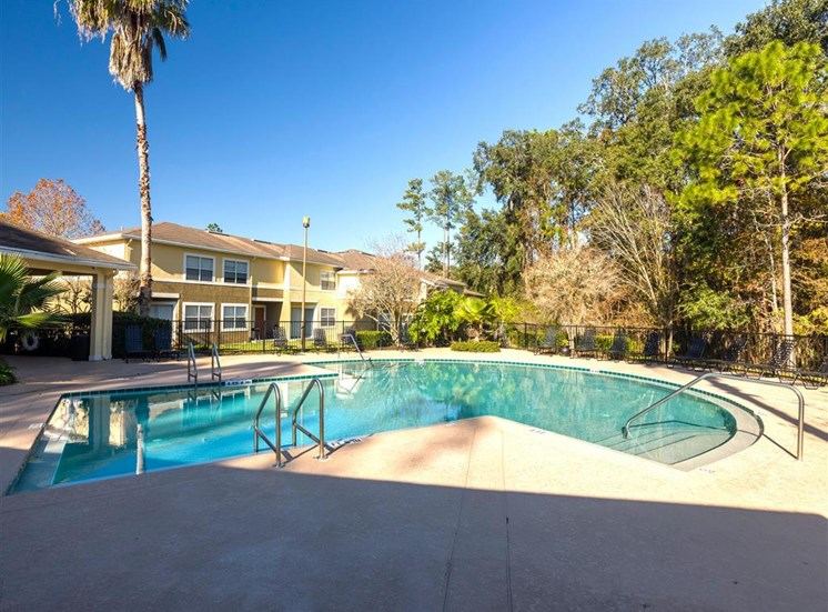 Swimming Pool With Lounge Seating at Holly Cove Apartments, Orange Park, Florida