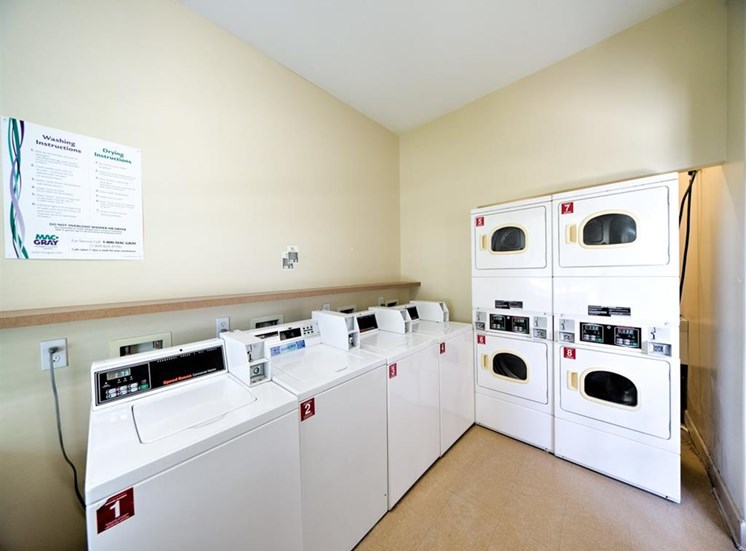 Clothing care center with washers, dryers, and folding station