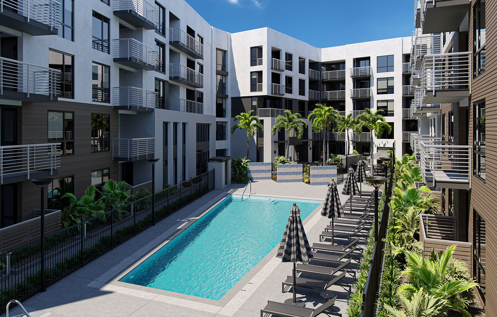 outdoor pool surrounded by apartment building