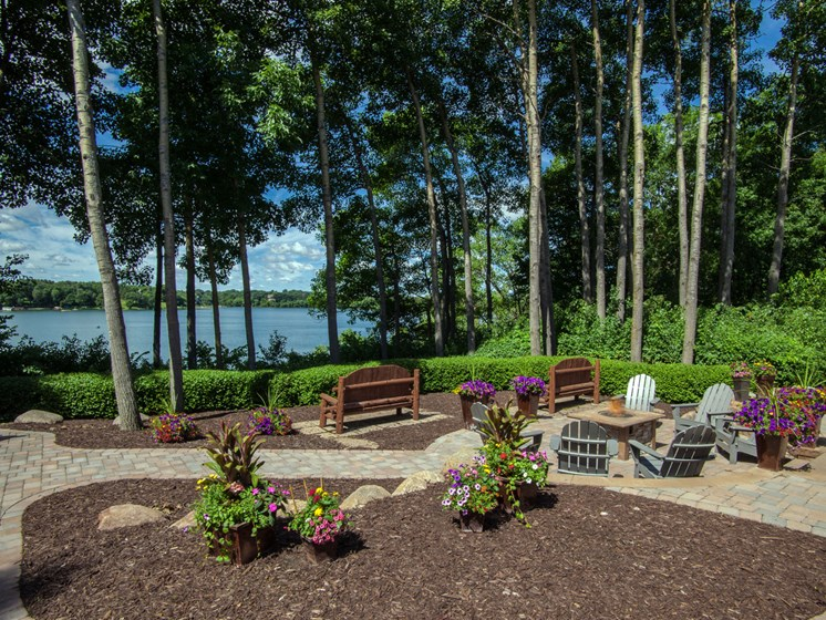 Lakeside Backyard Terrace + Fire Pit at Lake Susan Apartments in Chanhassen, MN
