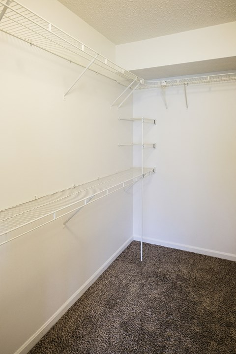 Large walk in closet with storage in master bedroom in Regency apartments Bettendorf, Iowa