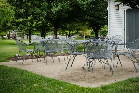 spacious clubhouse, outdoor patio with furniture, reserve small rental for guests inside and outside, at regency apartments in Bettendorf Iowa