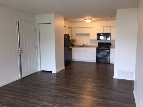 bright white clean cabinets, wood flooring, lots of storage at regency apartments in Bettendorf Iowa