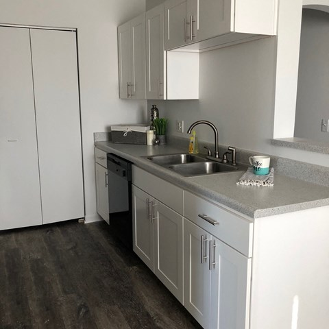 bright white clean cabinets, wood flooring, premium countertops and appliances at regency apartments in Bettendorf Iowa