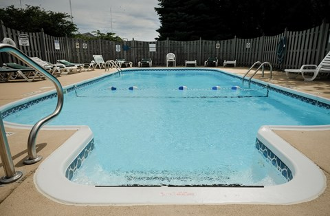 sparkling clean pool, crystal clear water, blue water, summer outdoor pool, at Regency Apartments in Bettendorf Iowa