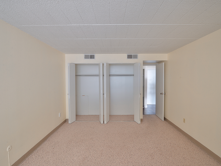 Bedroom with double closets, Walnut Towers at Frick Park high-rise apartments in Pittsburgh, PA