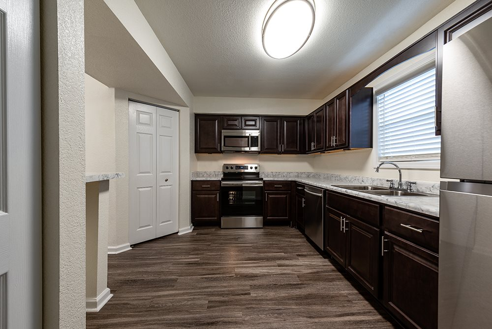 Kitchen with Dark Cabinets and Stainles Steel Appliances
