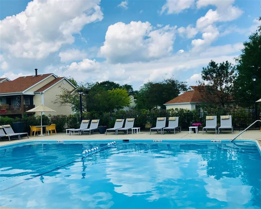 Lounge chairs by pool at The Winds at Poplar Creek, Schaumburg, Illinois