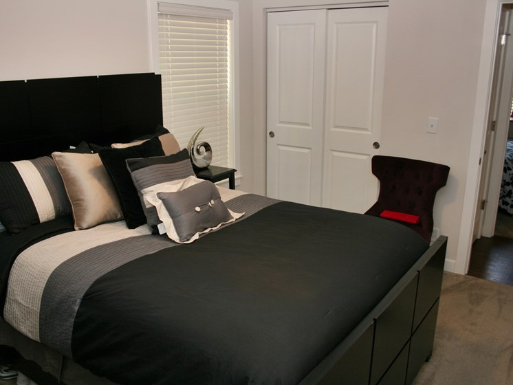Apartment bedroom furnished-Oakland Heights Apartments Exterior, Kansas City, MO