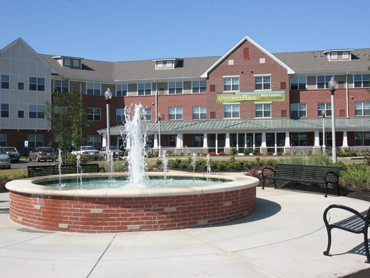Apartment building and fountain-Senior Living at University Place Apartments, Memphis, TN 38104