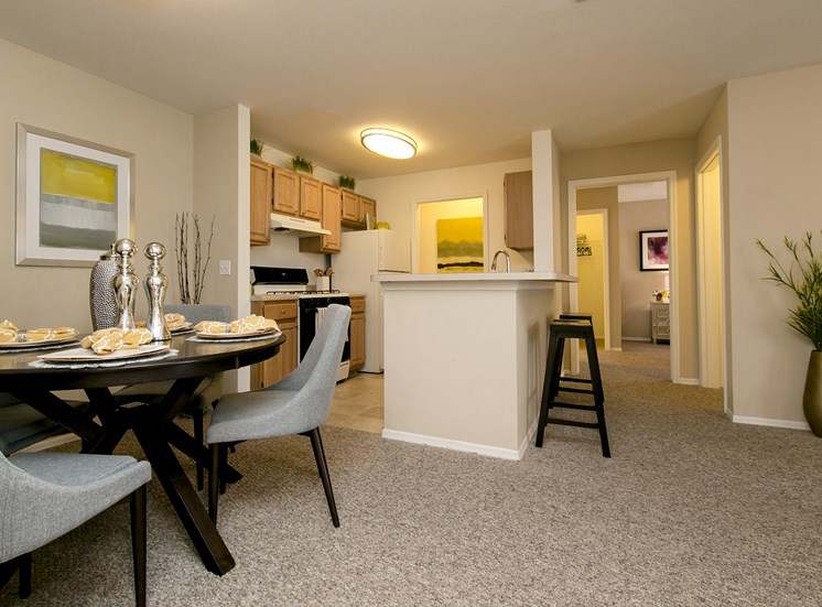 Dining Room and Kitchen at Belle Isle, for more communities, visit Concord Rents at ConcordRents.com