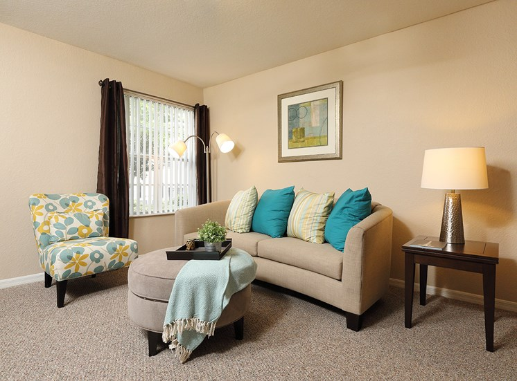 Living Room at Lake Harris Cove, for more communities, visit Concord Rents at ConcordRents.com