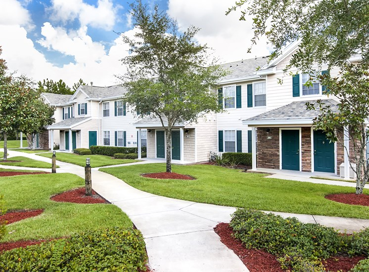 Apartment Home Building Exterior at Mystic Cove, for more communities, visit Concord Rents at ConcordRents.com