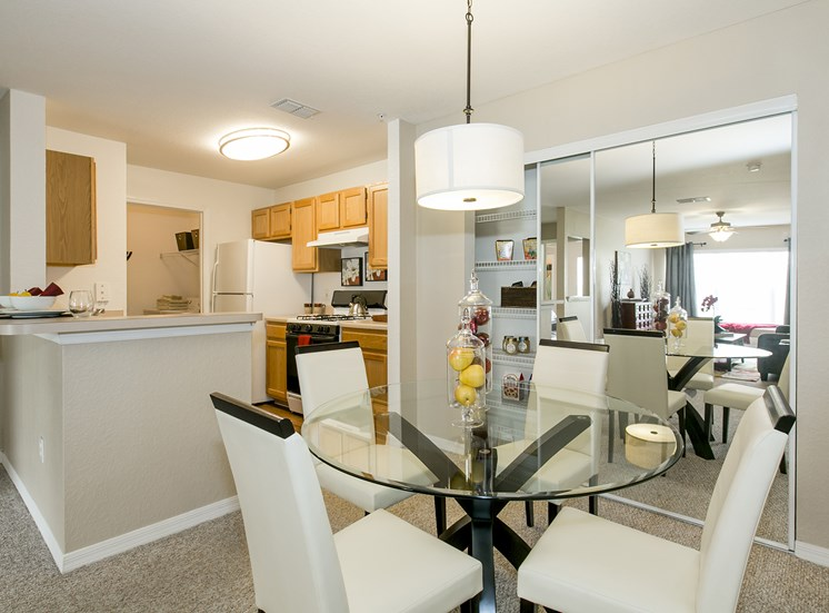 Dining Room and Kitchen at University Club, for more communities, visit Concord Rents at ConcordRents.com