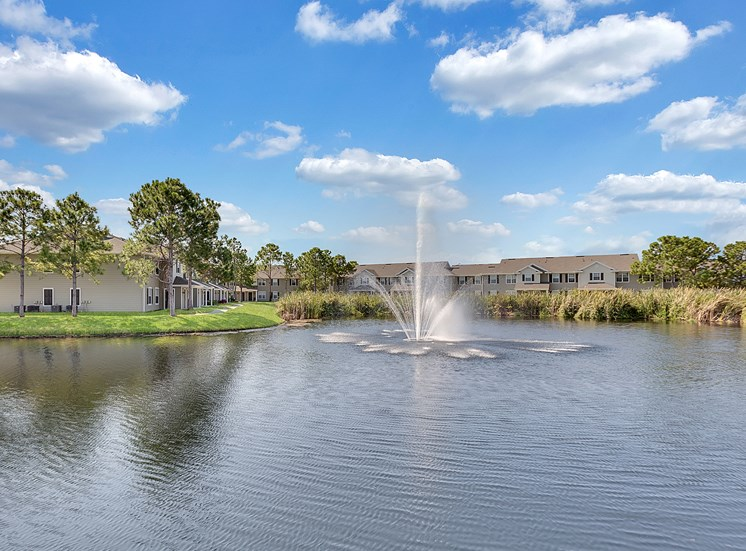 Village at Cortez Apartments for rent in Bradenton, FL. Make this community your new home or visit other ConcordRENTS communities at ConcordRENTS.com. Lake with buildings