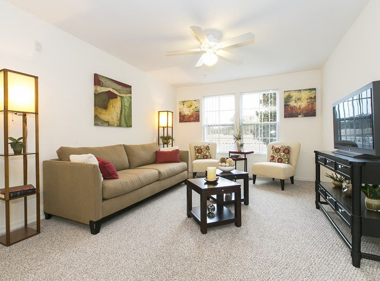 Apartment living room at Oviedo Town Centre. For more communities, visit Concord Rents at ConcordRents.com