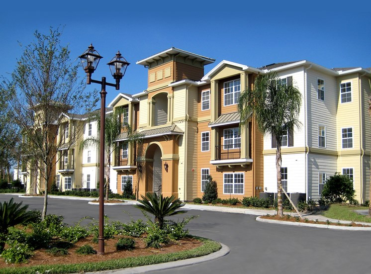 Apartment building exterior at Oviedo Town Centre. For more communities, visit Concord Rents at ConcordRents.com